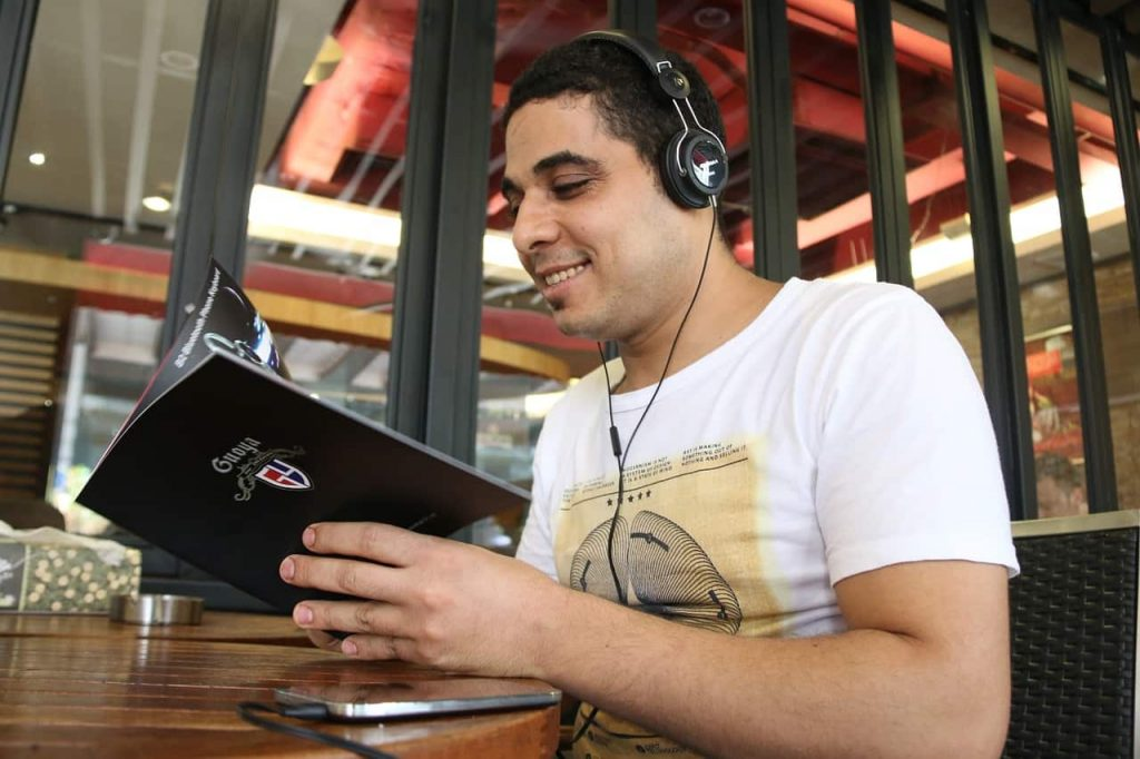 Man Listening While Reading