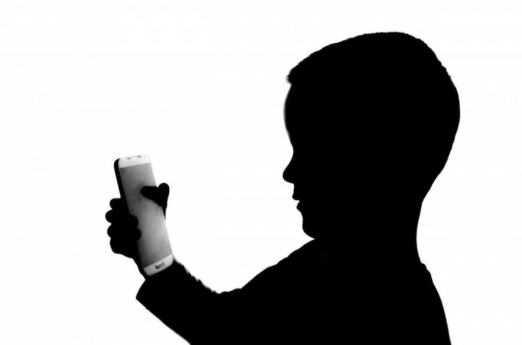Boy Looking At Phone Shadow